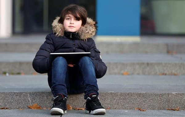 Nine-year-old Belgian student Laurent Simons, who studies electrical engineering and who will soon become the youngest university graduate in the world, poses at the University of Technology in Eindhoven, Netherlands November 20, 2019. Picture taken November 20, 2019