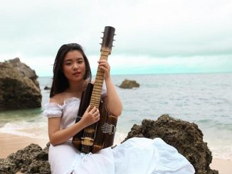 "Kyla Christie, Recipient of The Diana Award 2020, with her own created bamboo music instrument named ""Esthesque"" which means : beauty beyond the world"
