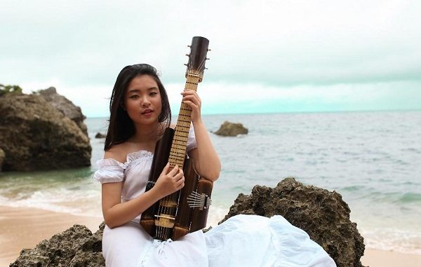 """Kyla Christie, Recipient of The Diana Award 2020, with her own created bamboo music instrument named """"Esthesque"""" which means : beauty beyond the world"""