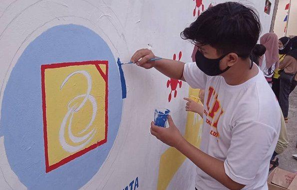 Mural bertema Covid-19 oleh Mahasiswa KKN Universitas Budi Luhur di Pedurenan